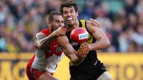 Alex Rance is tackled by Lance Franklin. Picture: Michael Klein