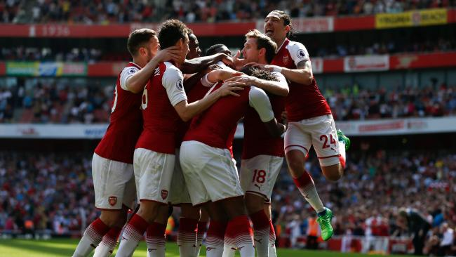 Arsenal's Spanish defender Nacho Monreal (C) is surrounded by teammates as he celebrates scoring the opening goal