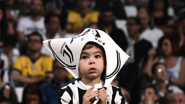 A young Juventus'supporter looks on