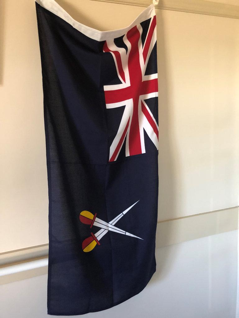 The flag that still hangs on Bob Larter's wall.