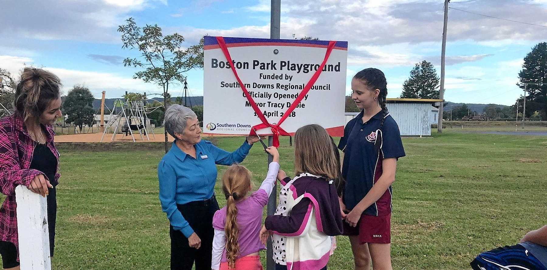 OFFICIALLY OPEN: Local kids help Mayor Tracy Dobie open the new playground.