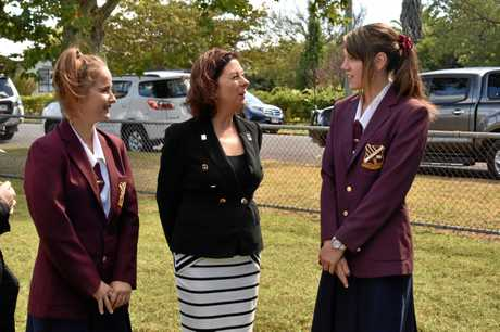 Queensland's Assistant Minister for Veterans' Affairs and Assistant Minister of State Jennifer Howard (centre) with Allora P-10 State School captains Chloe O'Halloran (left) and Charlize Wolff.