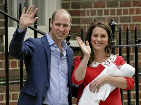 Britain's Prince William and Kate, Duchess of Cambridge wave as they hold their newborn baby son as they leave the Lindo wing at St Mary's Hospital in London Monday, April 23, 2018. The Duchess of Cambridge gave birth Monday to a healthy baby boy a third child for Kate and Prince William and fifth in line to the British throne. (AP Photo/Tim Ireland)