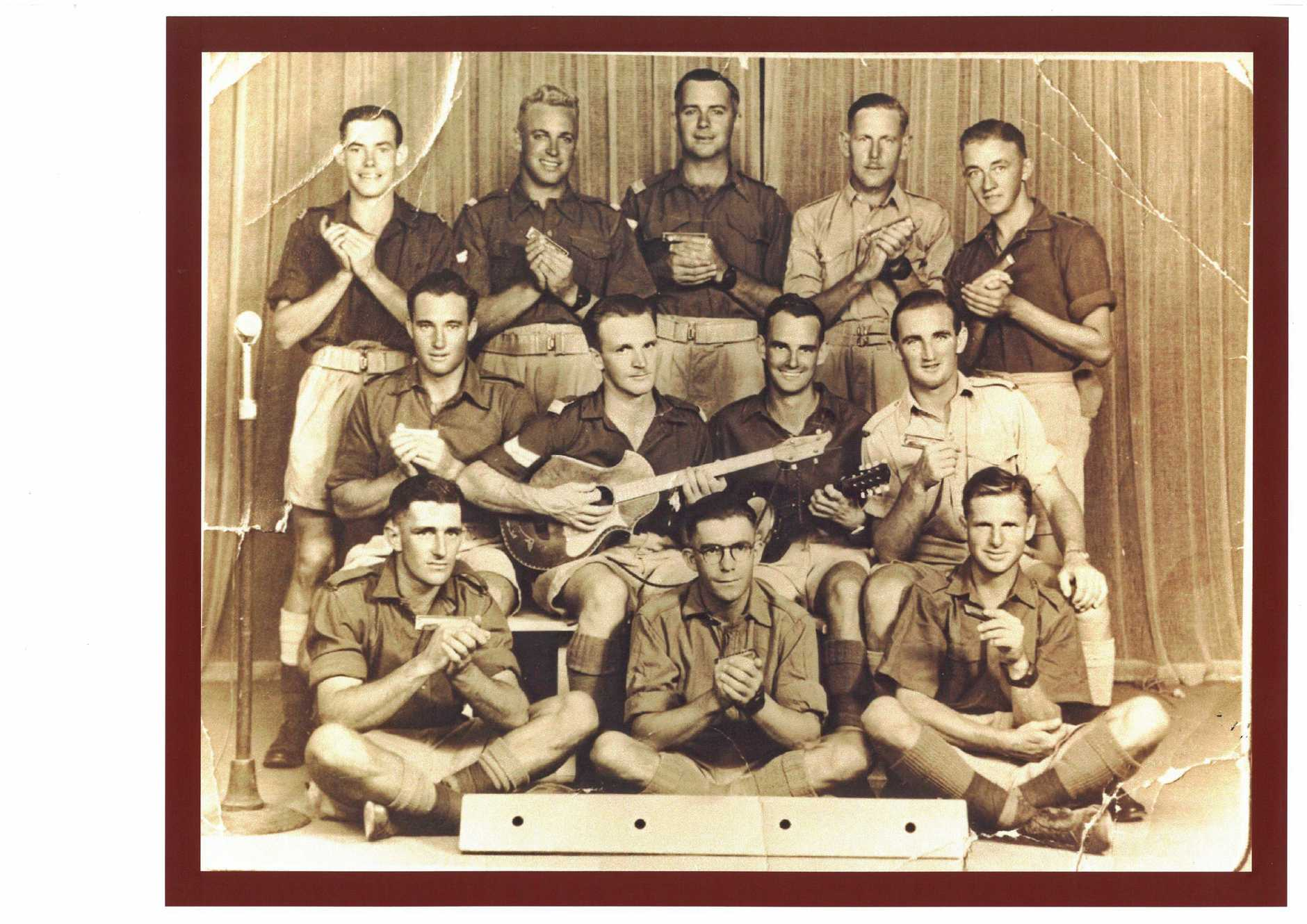 Signalman Con Robinson (bottom left, with his mouth organ band) served in Hollandia and Morotai during World War II.