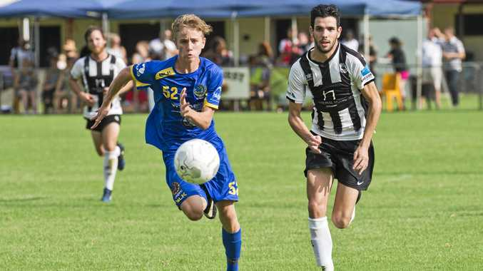 CUP CLASH: USQ's Cormac McCarthy (left) and Willowburn's Callum Hart battle for control of the ball. The two sides play today in the FFA Cup.