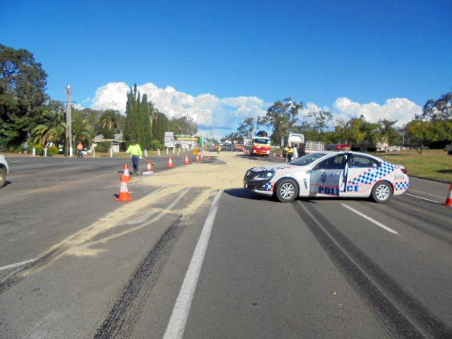 CRASH: THE Bruce Highway is down to one lane after a tanker carrying 21,000 litres of crude oil collided with a sedan.