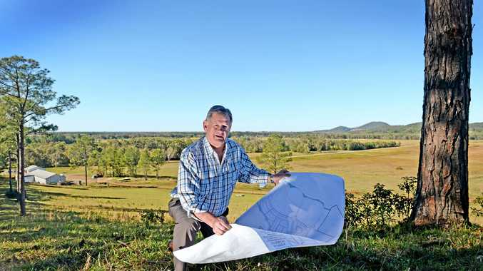 Leda Developments Tweed manager Reg van Rij looking over plans at Kings Forest some time ago. Leda believed its land would have been perfect for the new Tweed Valley Hospital.