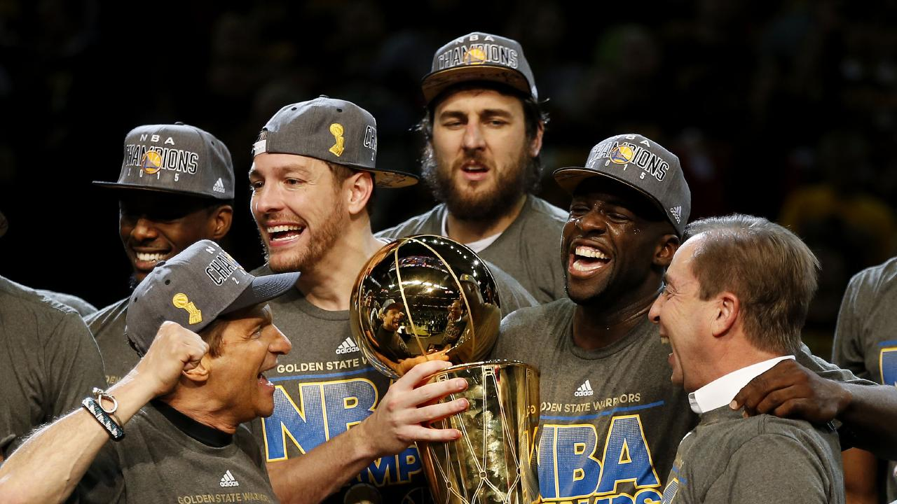 Andrew Bogut (top centre) celebrates Golden State's NBA championship win in 2015 with teammates Draymond Green, David Lee and franchise owners Peter Guber and Joe Lacob.