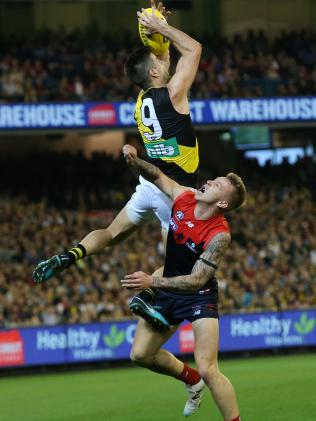 Tigers skipper Trent Cotchin got the crowd roaring with this speccy over James Harmes. Pic: Michael Klein