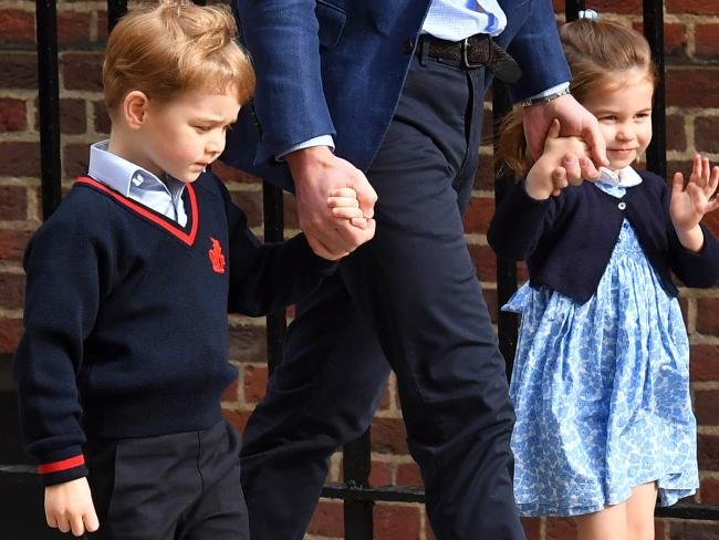 Charlotte, 2, smiled and waved to the cameras, while Prince George looked more pensive. Picture: AFP Photo / Ben Stansall