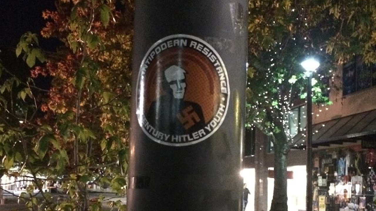 Stickers promoting the hate group have been posted all over Canberra.