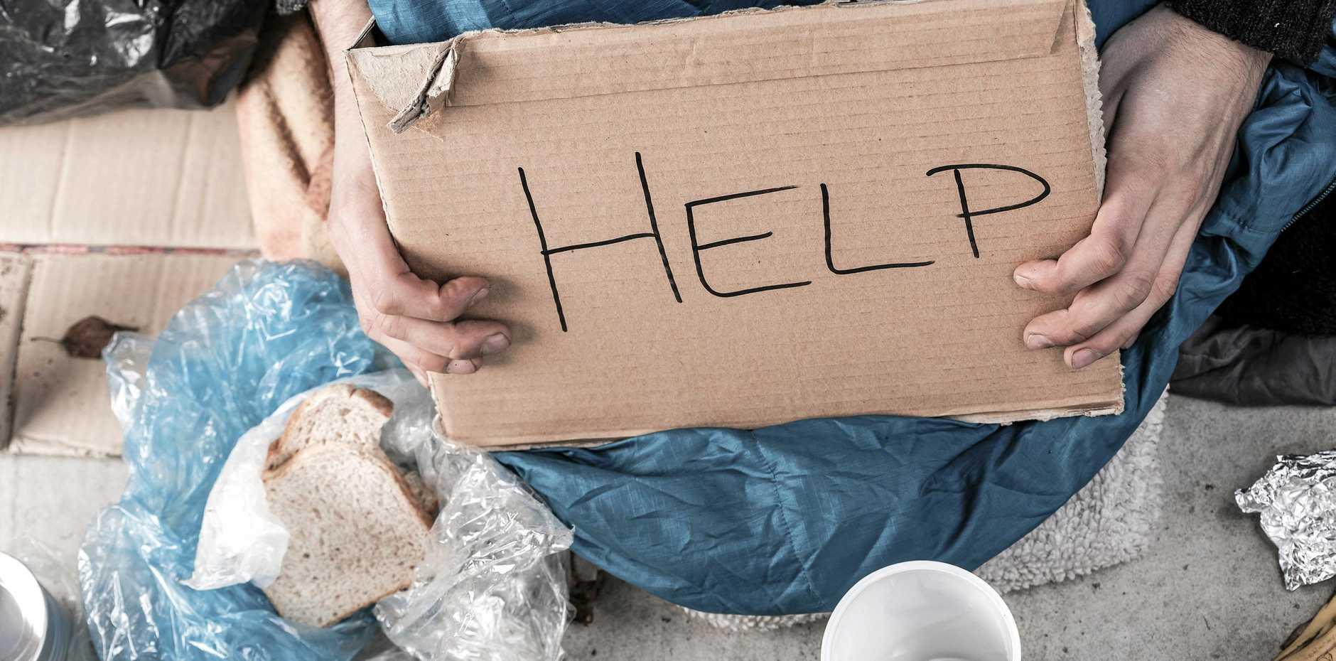Homeless man on the street asking for money