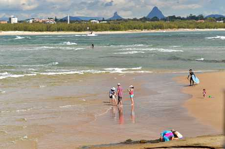 GENTLY DOES IT: Happy Valley, Caloundra, is a great place to learn how to surf.
