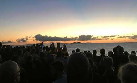 An attendee caught this image as the sun rose over the huge crowd at the Emu Park dawn service this morning.