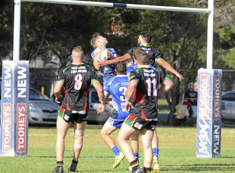 Cooper Woods climbs above the pack to take a high ball during the Group 2 first grade second round clash between Grafton Ghosts and Sawtell Panthers at Frank McGuren Field.