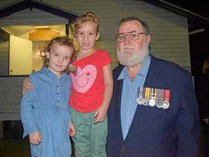 Veteran marches proudly with granddaughters by his side