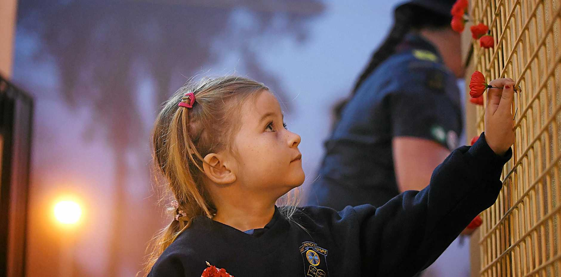 Emily Bonney pays her respects at Gympie's ANZAC Day dawn service, 2018.