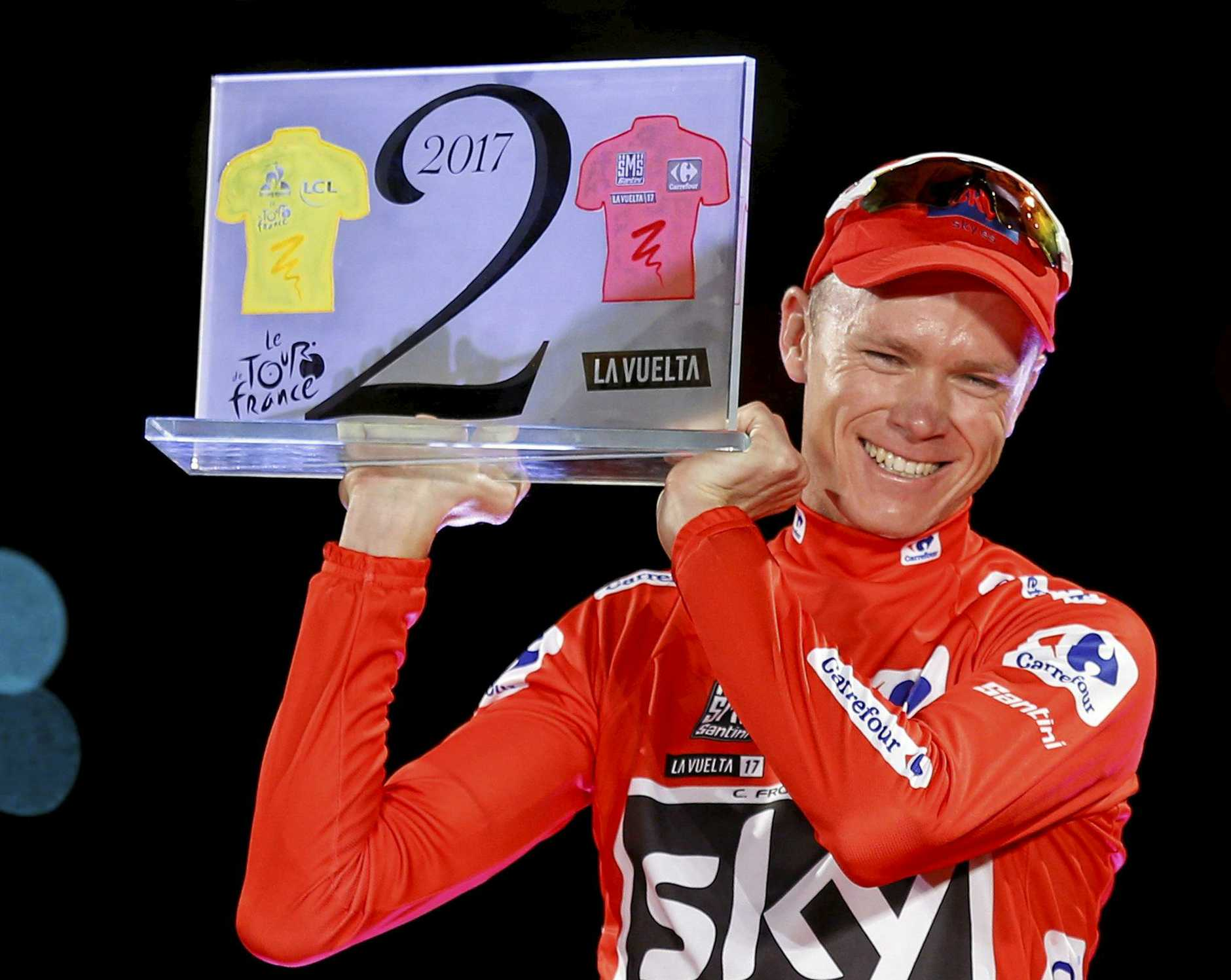 Britain's Chris Froome celebrates on the podium in Madrid after winning last year's Spanish Vuelta.