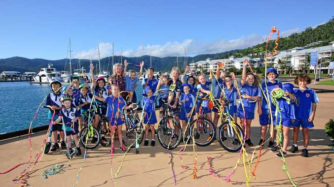 TOUR de CURE: Janelle 'Woody' Eastwood with a keen bunch of Tour de Cure supporters at the Port of Airlie Marina.