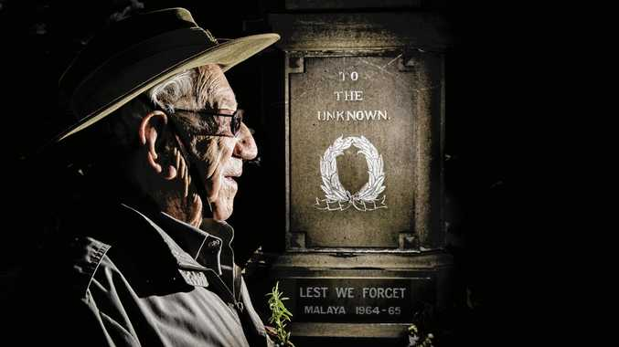 Henry Caldwell looks at the Grafton cenotaph after the main Grafton Anzac Day service.