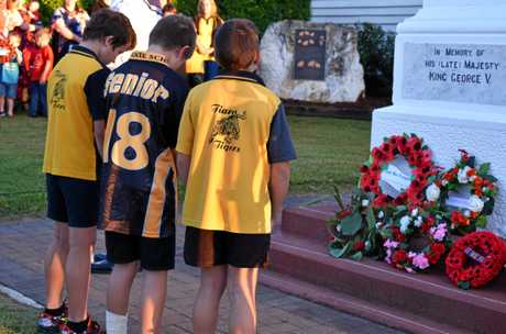 Tiaro State School senior students pay their respects at the Anzac Day dawn service.