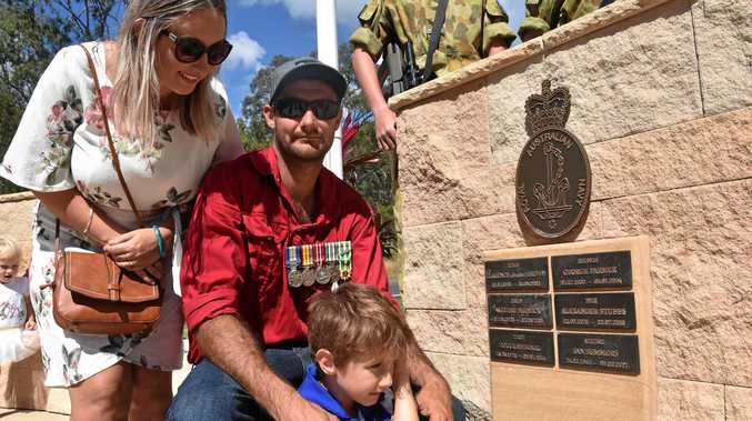 LEST WE FORGET: Averil, William and Carter Summers, 5, with a plaque honouring William's dad Ian Robert Summers at the Anzac Day service at Agnes Water.