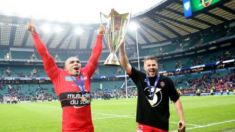 Bryan Habana and Drew Mitchell celebrate with the trophy following Toulon's European Rugby Champions Cup Final win over Clermont at Twickenham.