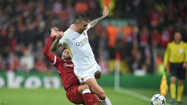 Liverpool's English midfielder Alex Oxlade-Chamberlain (L) picks up an injury