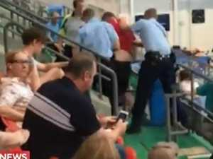 Coach arrested at swim meet