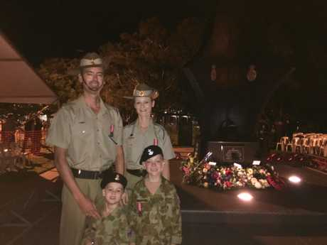 Private Michael Rutledge and Private Nicole Rutledge with their sons William, 4, and James, 7, at the Anzac Day Cotton Tree dawn service. Michael was in the catafalque party.