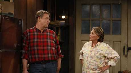 John Goodman and Roseanne Barr in a scene from the TV series Roseanne.