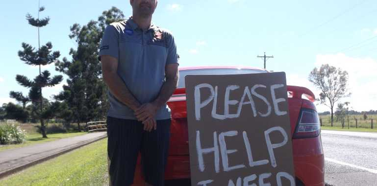 Rex Peters has resorted to creating a sign and standing on the side of the road to find employment in the Fraser Coast.