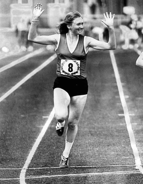 Image from HWT book 'MOMENTS IN TIME'. Portrait gallery. Sprinter Raelene Boyle after winning the 100m sprint at Aberfield Park. VWAAA. Neg: FL24182