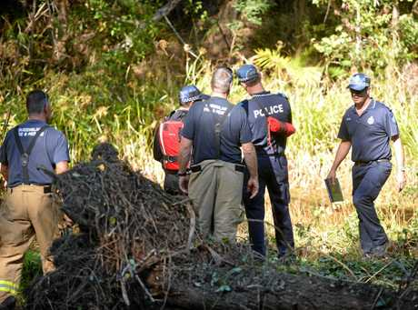 Police search a creek on Main Creek Road, Tanawha, for information on murder victim George Gerbic.  Photo: Warren Lynam / Sunshine Coast Daily