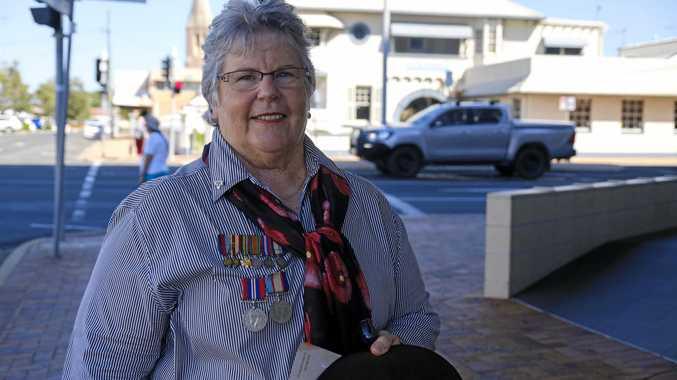 Gail McKewen wears parents' medals.