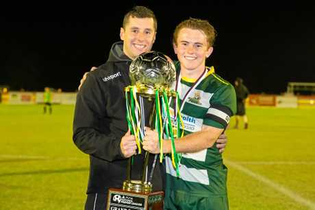 Western Pride coach Graham Harvey and captain Jesse Rigby with last year's grand final trophy.