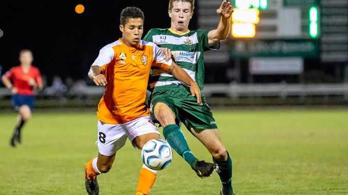 Western Pride defender Will McFarlane duels with a Brisbane Roar Youth opponent during his team's latest 6-1 victory at the Briggs Road Sporting Complex.