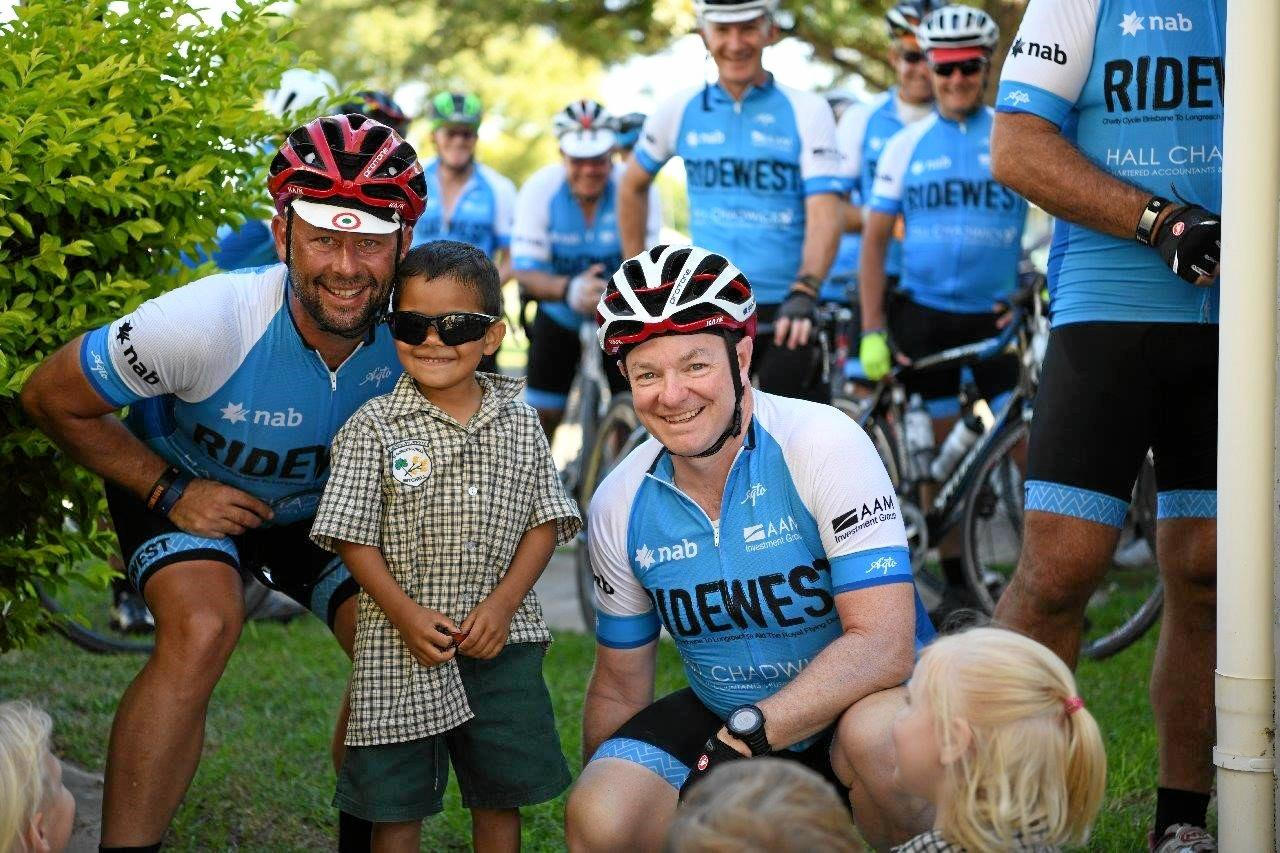 JUST KEEP RIDING: RideWest riders, Tony McIntosh and Greg Hefferan, stop in at Mitchell to visit students at St Patrick's Catholic School during the 1200km ride.