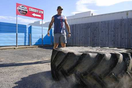 Coach Michael Murphy from Total Fitness Bundaberg flips a tyre; the CrossFit box will be holding a competition in April.