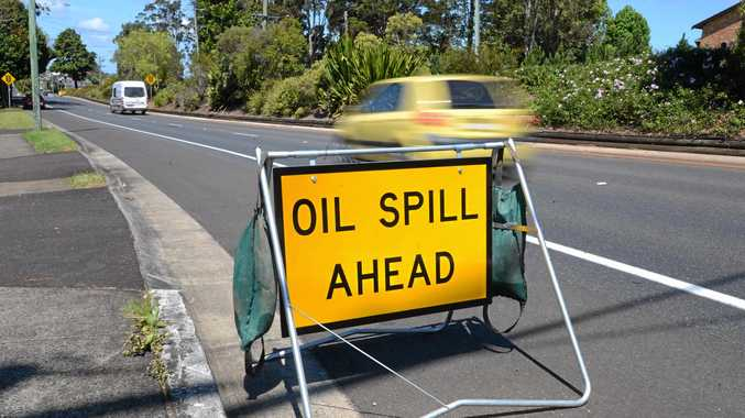 CAUTION: Oil spill on major road