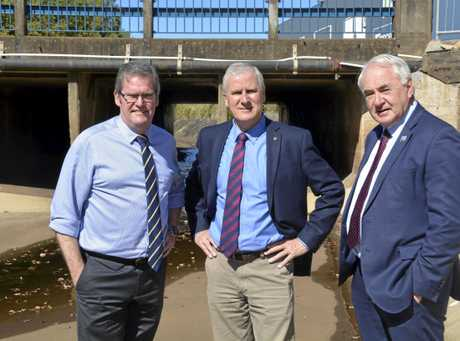 IN PRINCIPLE: Inspecting the West Creek detention basin are (from left) Groom MP and Minister for Regional Australia John McVeigh, Acting Prime Minister Michael McCormack and Toowoomba Mayor Paul Antonio.