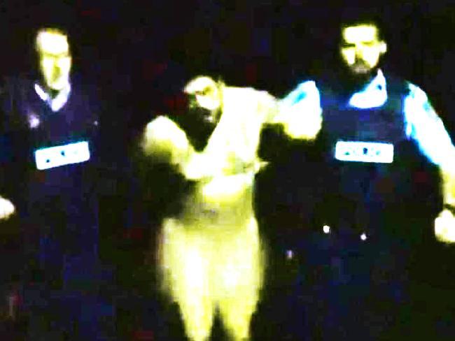 """Police arrest Keskin during the """"Naked Bikie"""" incident."""