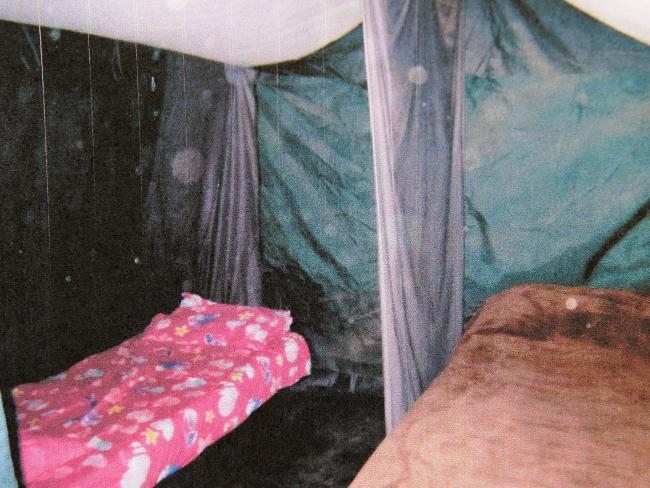 Inside a squalid tent on the Colt family's filthy property near Boorowa, NSW.