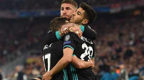 Sergio Ramos celebrates Real Madrid's impressive away win in Germany.