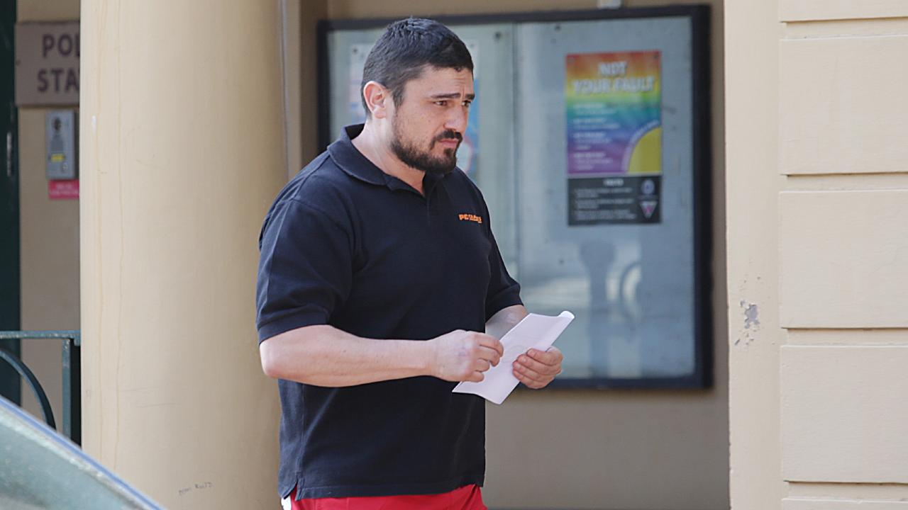 Erkan Keskin leaves Paddington Police Station as part of parole conditions over a 2015 incident.