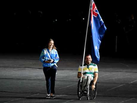 TV audiences were never shown Kurt Fearnley carrying the Australian flag as a result of a controversial decision by Games organisers. Picture: AAP Image/Darren England