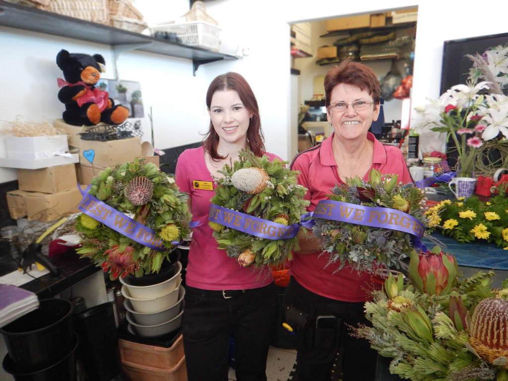 Emma Drury and Jan Koivunen florists at Jan's Florist shop working on wreaths for Anzac Day.Photo Mike Richards / The Observer