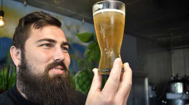 Adrian Cubit admires new beer. New Toowoomba Lager created at 4 Brothers Brewing by owners, Adrian Cubit and Katelyn Garner. April 2018
