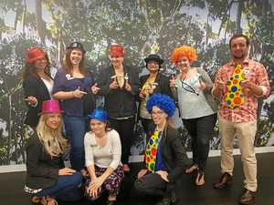 City bankers clown around in support