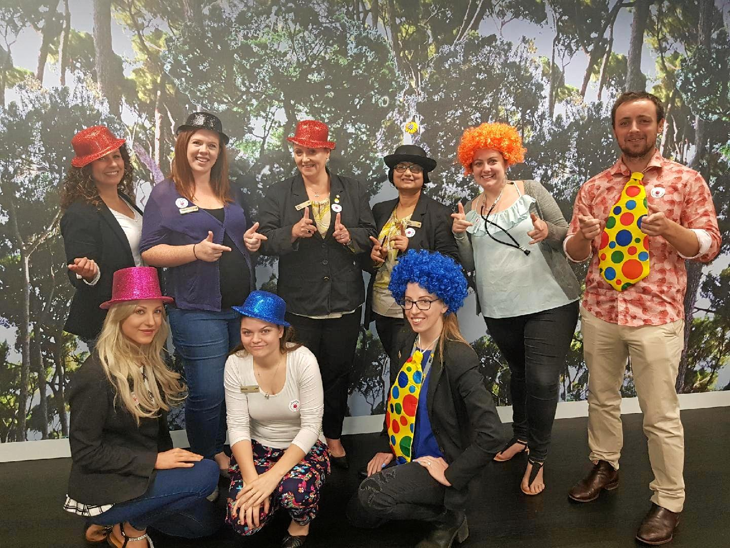 BRIGHTENING LIVES: Supporting the Clown Doctors are Commbank Toowoomba employees (back from left) Renee Hetherington, Michaela Rayner, Stella Martin, Sarita Krishna, Jodie Hammond, Sam Curtis, (front from left) Rebecca Aberdeen, Brittney Burns and Cassie Aberdeen.